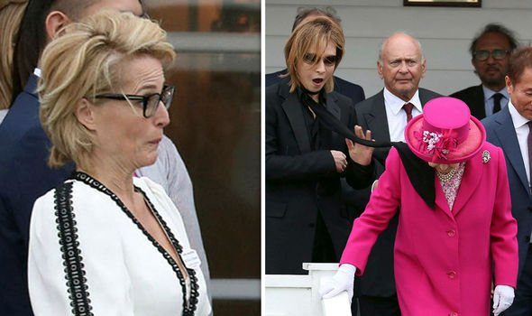 Royal shock Gillian Anderson left watches as a scarf blows into Queen Elizabeth II Image PA