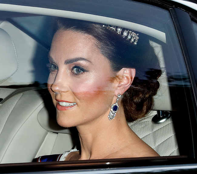 She wore sapphire and diamond earrings loaned by the Queen Photo C Getty Images