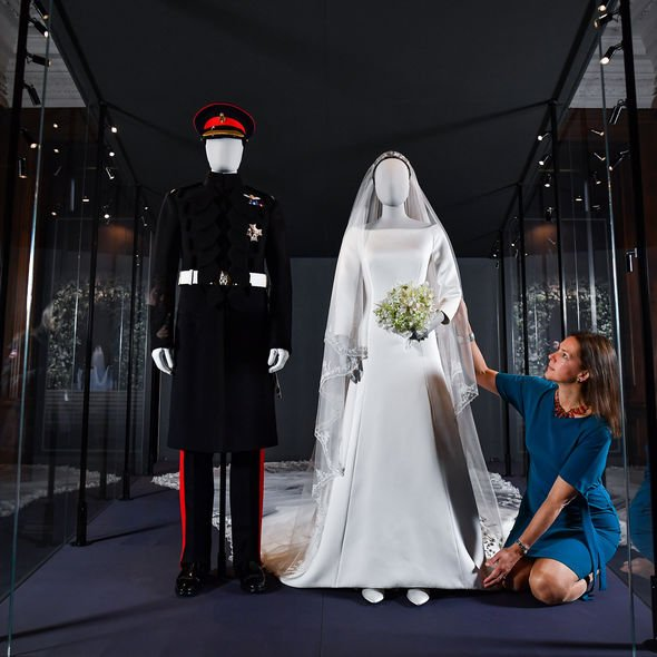 The iconic Givenchy gown is displayed in a glass cabinet alongside Harrys outfit Image GETTY