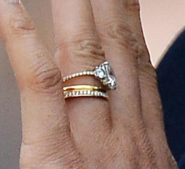 The new thinner band pictured is more in keeping with Meghans love of dainty jewellery The Duchess also wears her wedding ring and a third diamond ring Photo C GETTY IMAGES