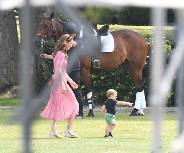 At one point an excited Louis was spotted running along the sidelines before Kate picked him up Image SPLASH