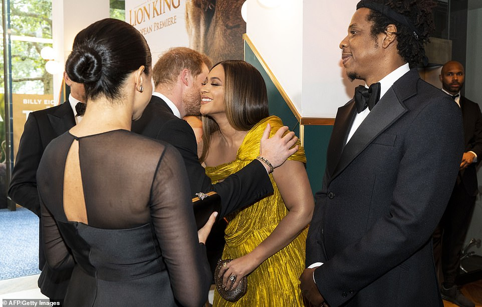 Beyoncé beamed as she embraced Prince Harry before the group shared a short chat at the European premiere of The Lion King