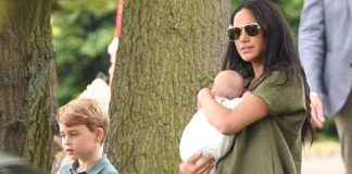 Doting mum Meghan Markle sweetly kisses baby Archie during his first public outing Photo C GETTY IMAGES