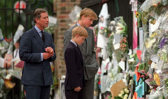 Harry Charles and William look at the flowers from mourners Image GETTY