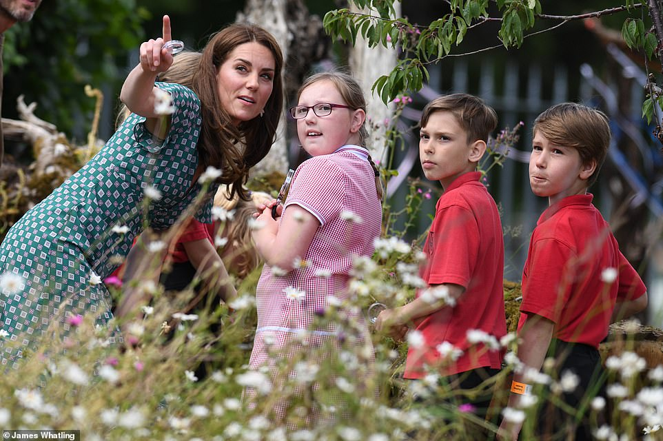 Helping hand The Duchess of Cambridge spent time insect spotting with some of the children Photo C Getty Images