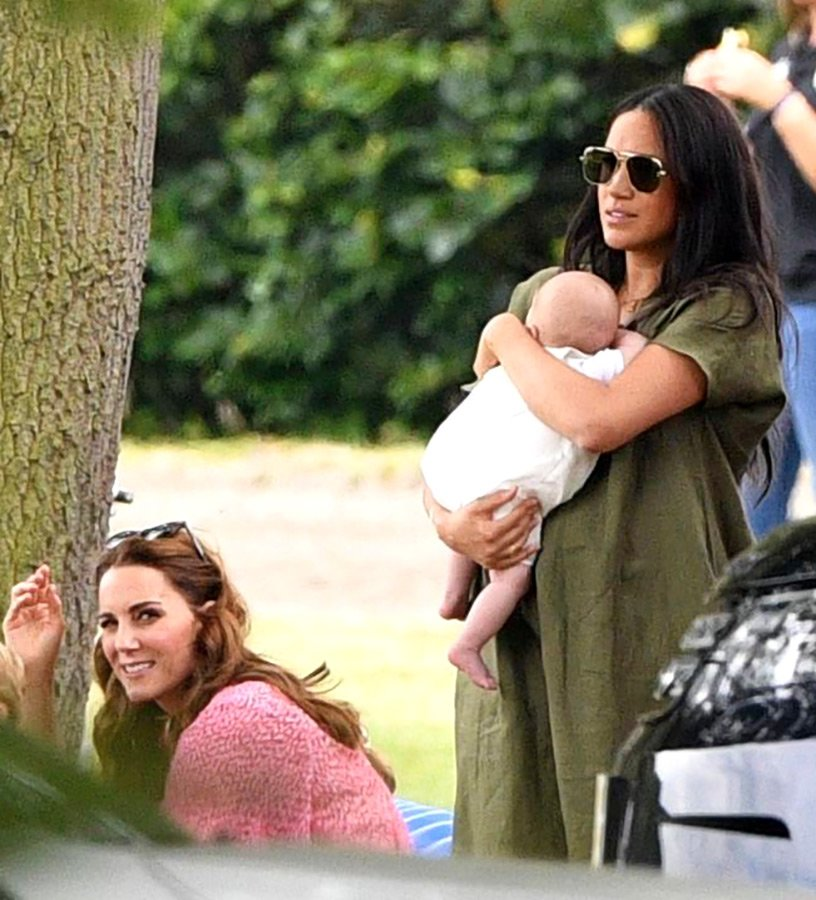 Kate Middleton Archie and Meghan Markle TIM ROOKE SHUTTERSTOCK