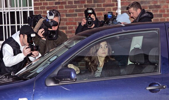 Kate trying to drive away surrounded by cameras Image GETTY