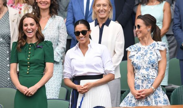 Meghan Markle and Kate were all smiles at Wimbledon on Saturday Image Getty
