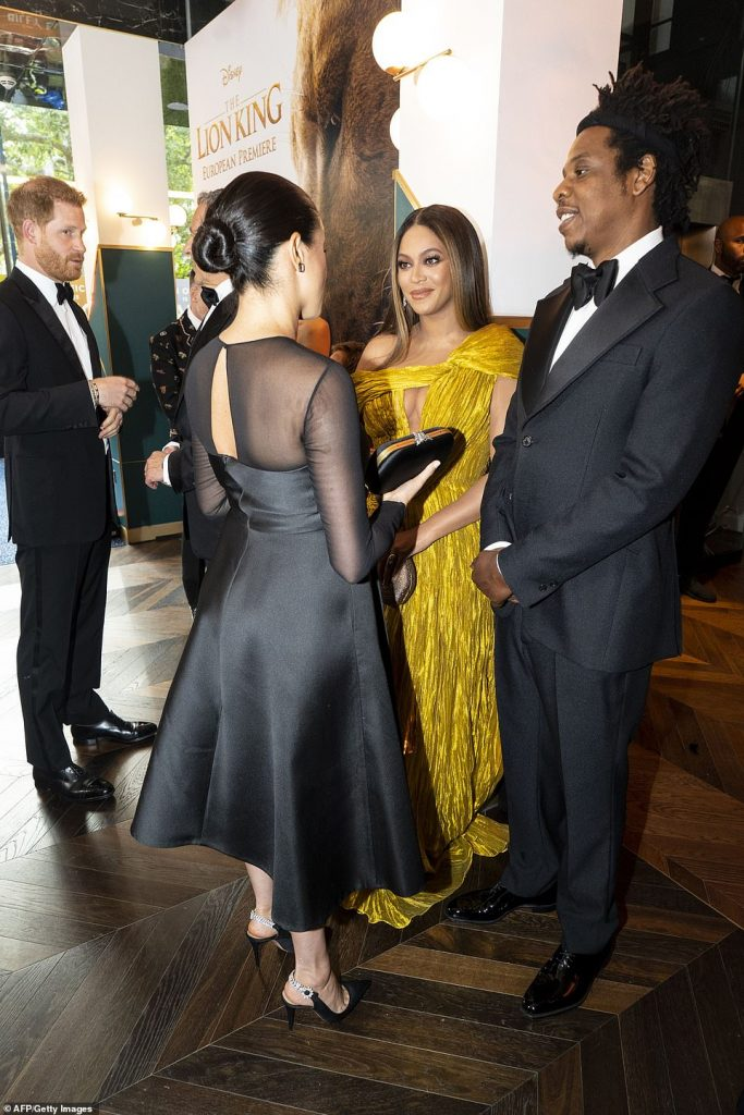 Meghan and Harry paused to speak to Beyoncé and her husband Jay Z while they met the cast ahead watching the latest Disney remake