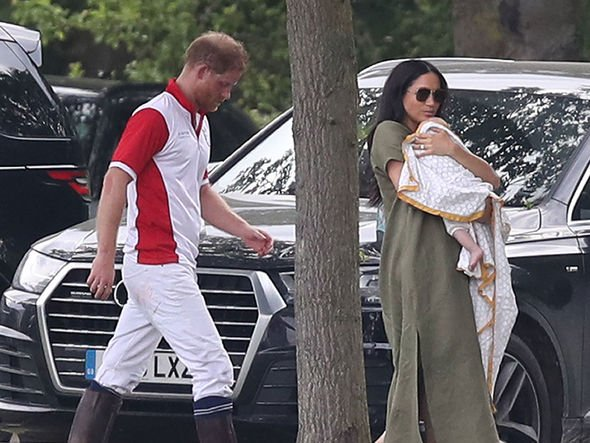 Meghan doted on her two month old son during the family day out Image PA
