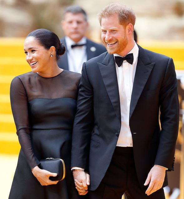 Meghan wore a Jason Wu black mesh panel flared dress to the Lion King premiere Image Getty