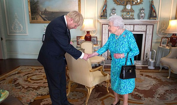 Prime Minister Boris Johnson bowing his head as he shook Queens hand Image GETTY