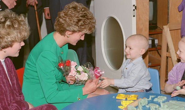 Princess Diana receives flowers from three year old Philip Lott at The Royal Marsden Hospital Image GETTY