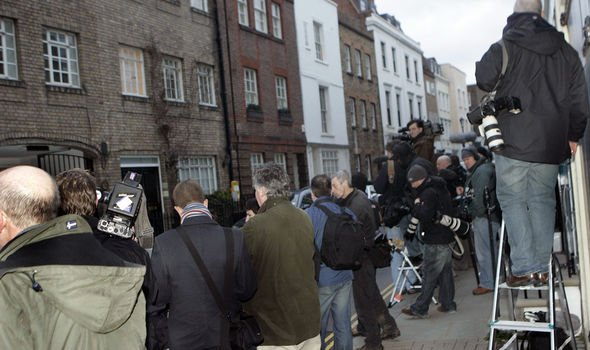 The paparazzi waiting on the street outside Kates flat Image GETTY
