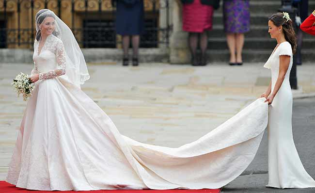 They first collaborated with Kate in to embroider her wedding dress veil and shoes Photo C GETTY IMAGES