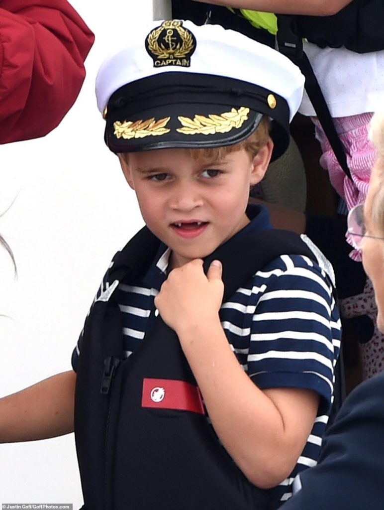 A gap toothed Prince George six looked the part as he donned a captains hat as he cheered on his parents alongside sister Princess Charlotte four at the inaugural event