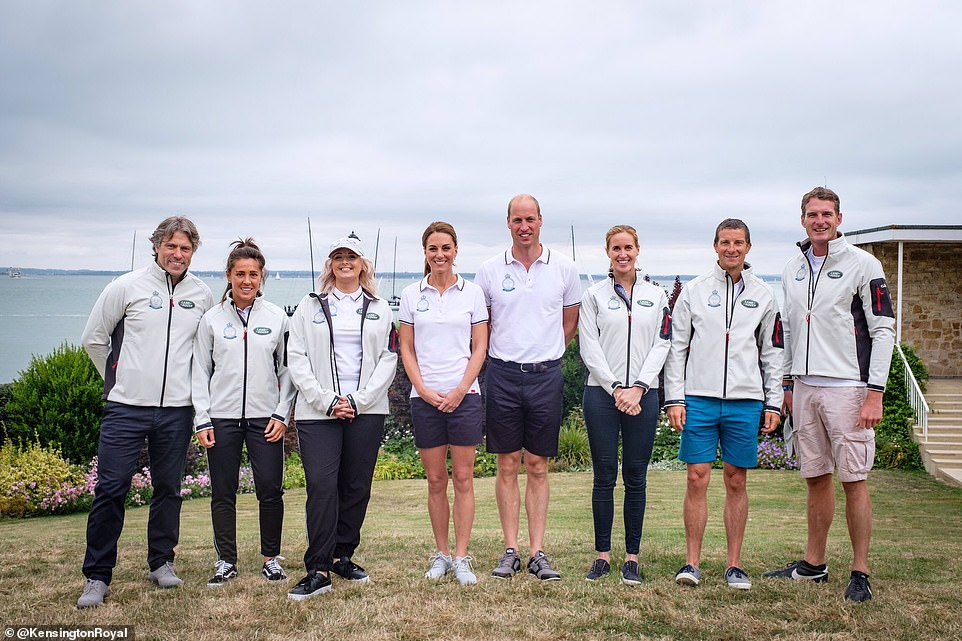Ahead of the race Kate made a quick outfit change into a white polo shirt and navy shorts The royal posed alongside husband Prince William