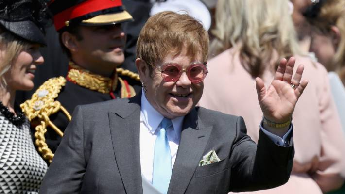 CHRIS JACKSON GETTYSir Elton John arrives at the wedding of Prince Harry to Meghan Meghan Markle at St Georges Chapel Windsor Castle on May in Windsor England