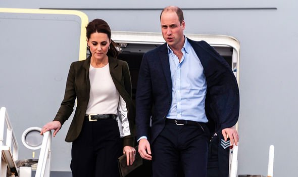 Kate and Prince William were spotted boarding a commercial flight with their three children Image GETTY