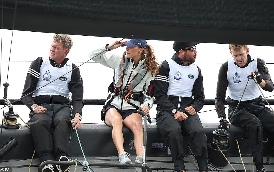 Kate could be seen holding onto her cap amid the windy weather conditions as she continues to take part in the Kings Cup regatta at Cowes on the Isle of Wight