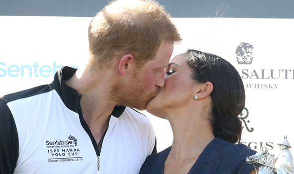 Meghan Duchess of Sussex and Prince Harry Duke of Sussex kiss Image GETTY