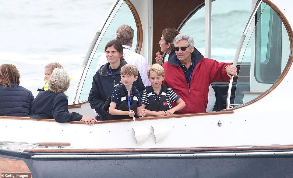 Michael Middleton dons a red jacket and sunglasses as an excited Prince George six cheers on his parents as they take part in the inaugural Kings Cup regatta