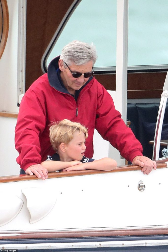 Michael Middleton looks on as Prince George watches the inaugural Kings Cup regatta hosted by his parents the Duke and Duchess of Cambridge in Cowes