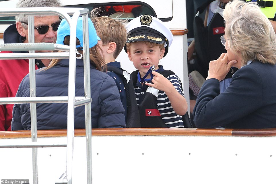 Prince George showed off his gap toothed smile as he joined grandfather Michael Middleton dressed in a nautical inspired outfit