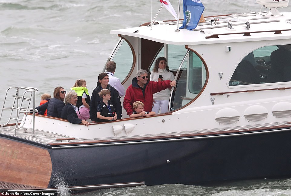 Prince George was seen resting on the edge of the boat as he waited in anticipation to see which of his parents would cross the finishing line first