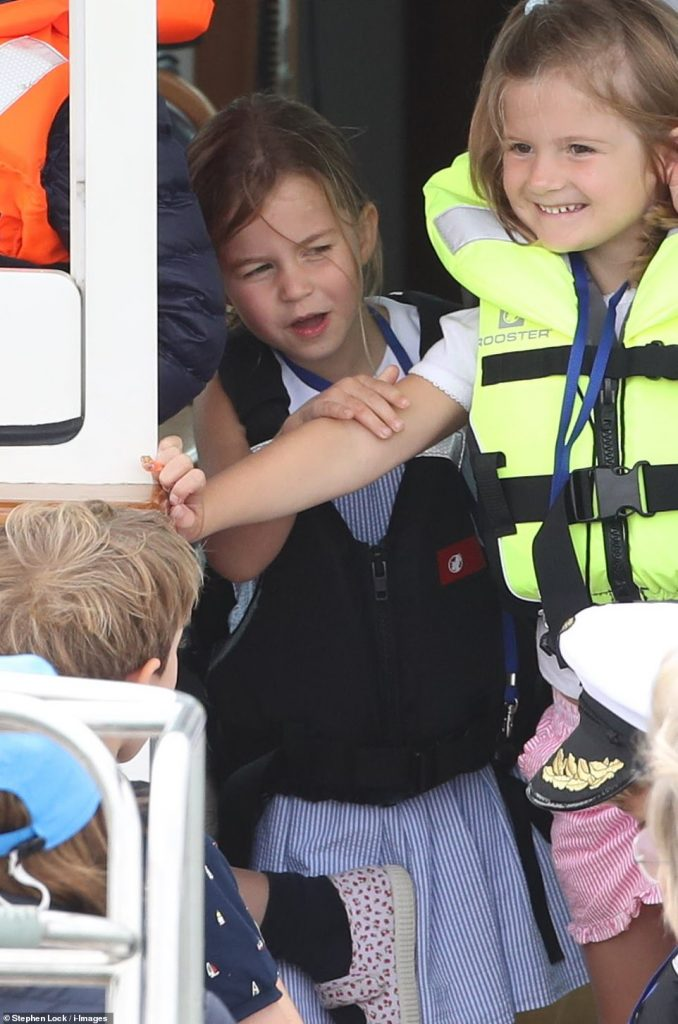 Princess Charlotte four wore a nautical inspired striped dress from Ralph Lauren kids £ and a life jacket as she watched over the edge of a boat