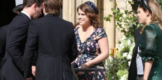 Princess Eugenie stuns onlookers in a purple navy mix floral dress at Ellie Gouldings star studded wedding Photo C GETTY IMAGES
