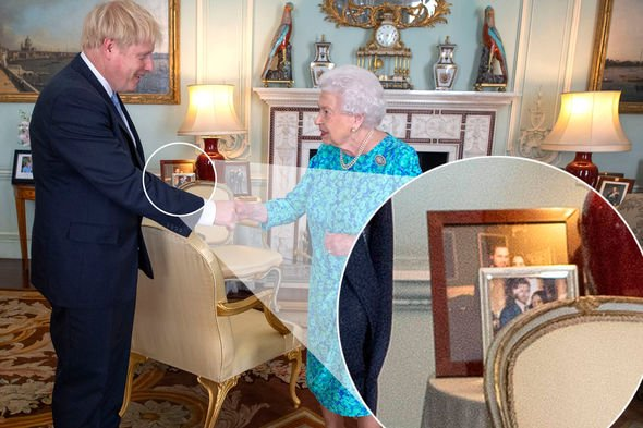 Queen snub The photos in the background show Meghan and Harrys picture at the front Image PA
