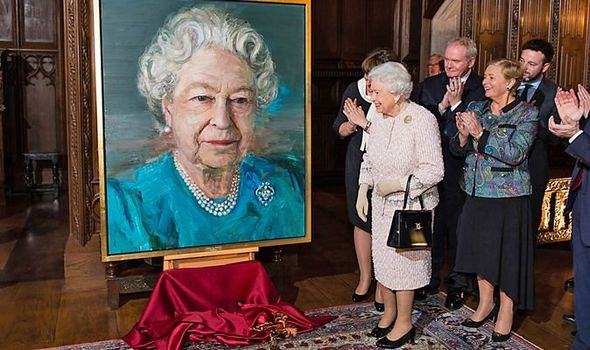 The Queen unveils a portrait in Image Jeff Spicer WPA Pool Getty Images