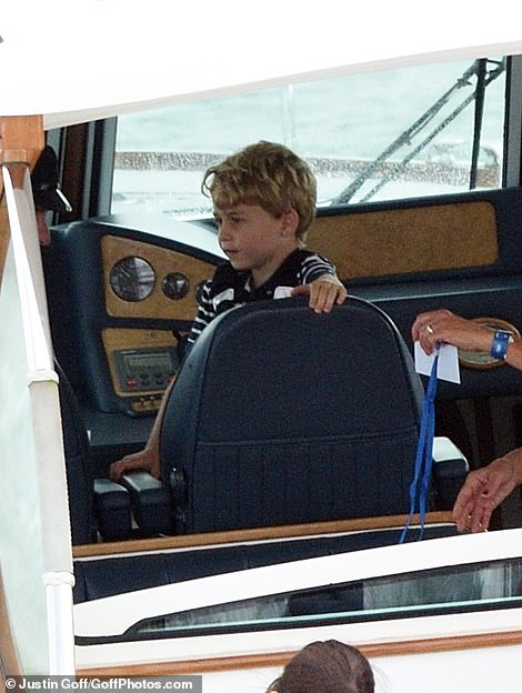 The young royal looked at home as he took to the captains seat before coming over shy and hiding behind a post on the boat