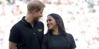 cropped Harry and Meghan at a baseball game in June Photo Getty