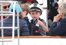 cropped Prince George showed off his gap toothed smile as he joined grandfather Michael Middleton dressed in a nautical inspired outfit