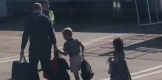 cropped The Duke of Cambridge can be seen with his children at Aberdeen airport this morning