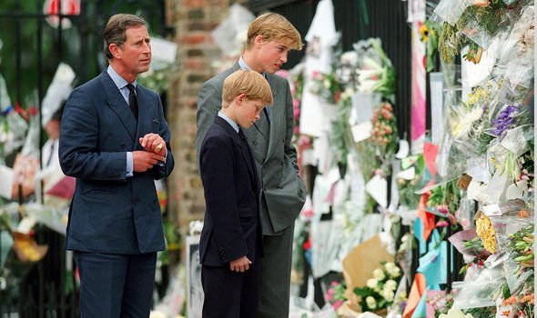 Charles William and Harry look at flowers from mourners Image GETTY