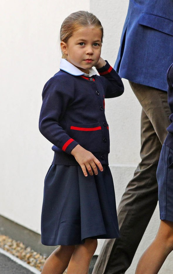 Charlotte wore her hair neatly in a ponytail on her first day Image PA