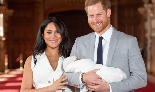 Meghan Markle and Prince Harry holding their first child Archie Harrison Image PA