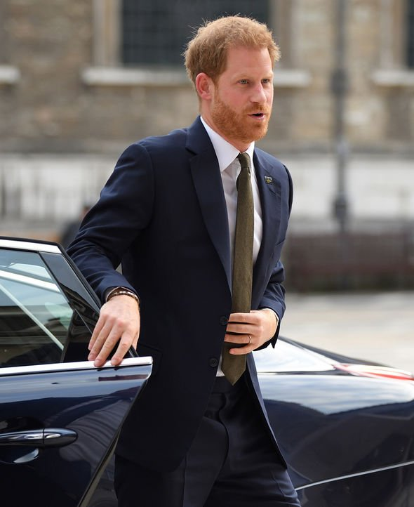 Prince Harry shut his own car door in London on Tuesday Image GETTY