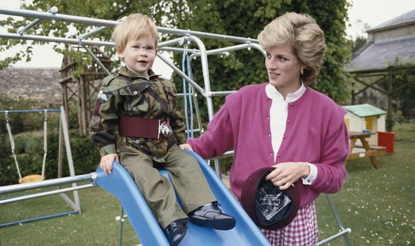 Princess Diana with a young Prince Harry at Highgrove Image Getty
