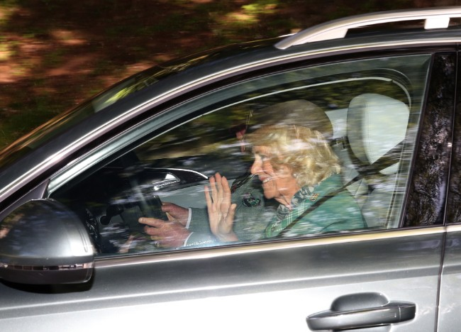 The Duchess of Cornwall waved to people who had gathered to greet the royals Photo C GETTY IMAGES