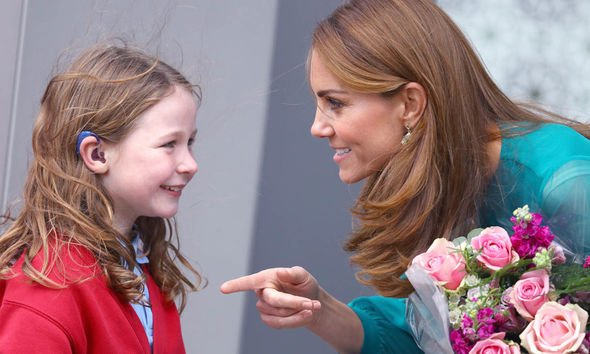 Kate brings a smile to the face of a little girl at the Aga Khan centre