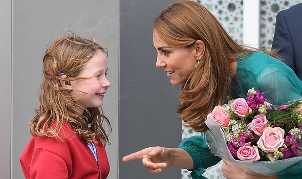 Kate received flowers by a girl who waited for her outside of the Aga Khan Centre Image PA