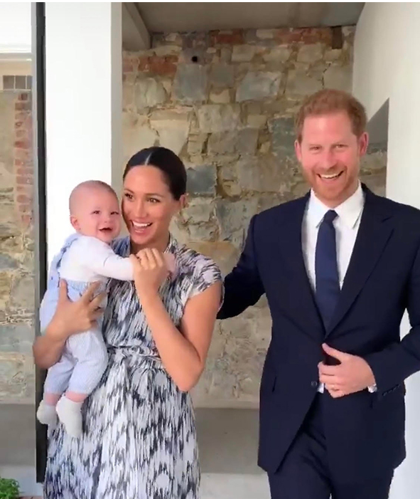 Meghan looked incredible in her Club Monaco dress carrying baby Archie Photo C GETTY IMAGES