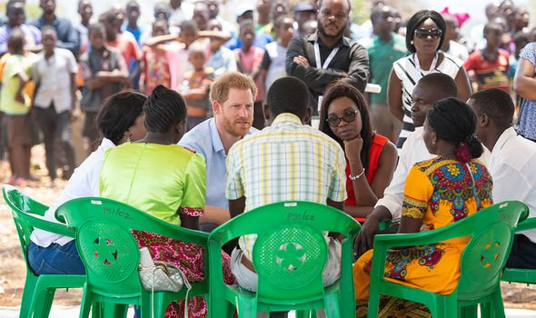 Prince Harry sat down with youngsters outside the health clinic in Malawi Image GETTY