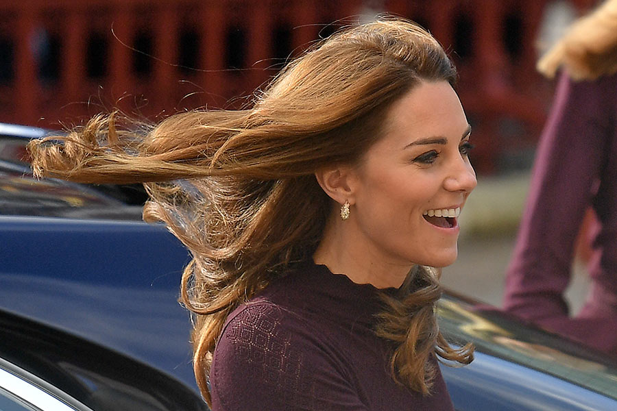 The Duchess had her hair styled in her trademark perfect blowdry which showed off her Asprey Photo C GETTY IMAGES