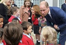 cropped William and Kate charm children at London's Aga Khan centre yesterday Image REUTERS