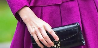 Kate Middleton steps out in Norfolk wearing a purple coat dress and a dreamy Aspinal clutch bag PhotoC GETTY